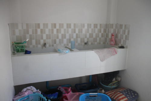 Girl's laundry sinks for hand washing clothes.