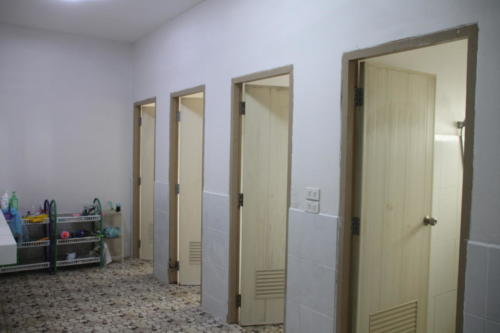 Girl's bathroom – toilets and showers.