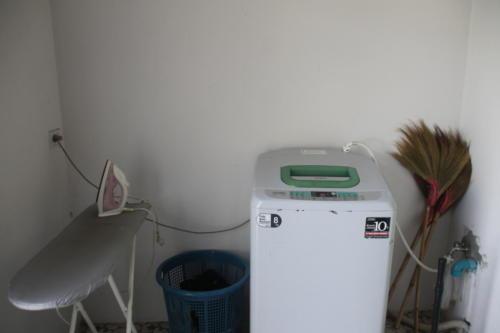Girl's laundry – washing machine.