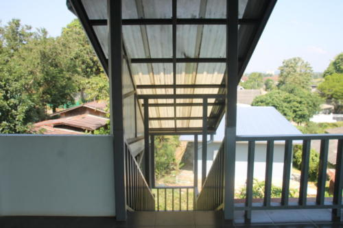 View down the back stairs from the 2nd floor patio.