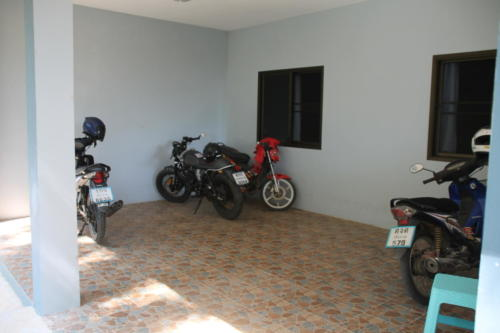 Motorcycle parking area at boy's house.